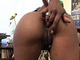 This sexy black girl is lubing up this guys big cock with a very slobbery BJ.  After finishing up her knobjob, she spreads her legs and takes a good fucking to her box.  Once he's done fucking her in the cunt, he beats up the back nine before busting all over her face.  