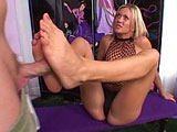Tayla Velize, a sexy blonde, is jerking this guy's big hard cock off with her feet.  After a little bit foot play, she finds herself deepthroating his cock.  Once she done gagging on cock, she sits back with her legs behind her head, and has her pussy pounded.
