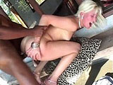 A petite blonde is getting fucked in the pussy by a well hung black guy. He nuts all over her perky tits.