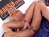 This sexy blonde is Jules Van Saint.  She is on the bed with her man going at each other.  He eats her out, and then she sucks on his big cock.  He stuffs her shaved pussy in a couple of positions and blows his load in her mouth.