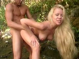 Julie Meadows, a smoking hot blonde, is out for a little hike when her guide tells her that they're lost.  The first rule survival is maintaining body temprature, and the best way to do that is to fuck.  So this hot blonde hops on her guide's big cock and gives it one hell of a ride.