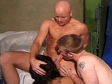 A cute Asian girl is having her pussy pounded by two very bi-curious men.   The girl sucks and fucks on both guys before strapping on her big rubber dick and throws it to both guys.