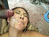 Envy Mi, a cute Asian, is sitting in a chair, rubbing her pussy, and staring at a big black cock.  When the black guy steps up to the plate, this slut plants his fuck stick into the back of her throat.  She gives him a hummer and masturbates.  She gets a cum mustache!