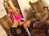Two scantily clad girls are fucking the hell out of each other's cunt with a strap on dildo.  They begin by finger fucking and playing with their sexy toys before straping on their big black dick.