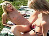 Two sexy blondes are ready for some real hot girl on girl fucking by the poolside.  The two hotties take turns straping on their robber cock and fucking hell out of each other's pussy.