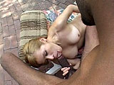 Stefany Mays, a cute blonde chick, sucks a really big black cock.  This horny cocksucker doesn't let the size set her back, and she feeds his schlong into her blow hole.  She is rewarded with a mouthful of semen at the end.