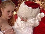 A sexy young strawberry redhead is ready to take Santa's big hard candycane up her cunt.  She slobbers Santa's big cock before having the jolly guy's package stuffed in her pussy.