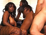 Two hot big titty black girls are having their cunts fucked by a big dick white guy.  The two girls sandwich the guy's cock in between their mouths.  They then take turns getting their pussy fucked before getting a big warm load sprayed on both their faces.