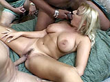 This busty blonde hottie is getting all of her holes plugged as her hubby watches and enjoys.  She starts by stuffing her mouth with two big cocks before letting the guys fuck away at all of her holes.  Before the guys blow their loads all over her face, they give her the good old double stuff.