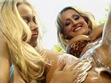 These two smoking hot blondes are by poolside shaving one another's pussy.  Before passing their strap on back and forth, they clean the shaving cream off each other's snatches with their tongues.
