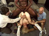 A sexy blonde, is getting fucked in her ass by a big black cock as her husband just watches.  She gives the black monster a thorough once over with her mouth before getting royally fucked in her ass.
