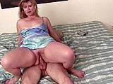 A sexy mature blonde is getting to live out her lifelong dream of being fucked by a big dick porn star.  After giving a blowjob to the guy, she gets her pussy fucked in multiples positions.  Before blowing his load in the chicks cunt, the dude stuffs a dildo in her box next to his big cock as he fuc