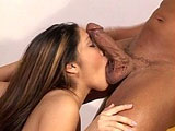 Nautica, a sexy Asian girl, gives some guy's big cock a lot of oral attention.  This sexy little girl's mouth fucks her way into a big mouthful of man goo.