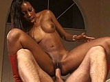 Black hottie Ashley Fox is giving this guy a red hot striptease.  After putting on her little show, she gets her pussy vigorously tongue fucked, and then she gets a thorough pounding.