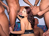 This sexy brunette finds herself having to entertain six guys.  So, she has a giant six on one gang bang.  She has no problem sucking on cock while being DPed.