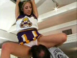 A very energetic brunette cheerleader fucks her cheerleading coach in her parent's kitchen.  Mom and dad aren't home, so she does what it takes to make the all star cheer squad.