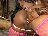 Sexy black porn stars, Angel Eyes and Jada Fire, are finger fucking one another. The two girls are soon joined by an older gentleman, and the girls use him as their sexual jungle gym.  They take turns pogo sticking up and down on his hard cock and grinding their pussy into his tongue.