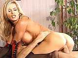 Hot blonde, Amber Lynn, is getting her pussy reamed out by a big hard dick. After drenching the guys cock in saliva, she gets fucked in her nice box in a bunch of different positions.