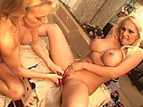 Big titty blondes, Mary Cary and Monica Mayhem, are getting buck wild with each other in the bathroom.  These two blonde bombshells are wearing two very sexy outfits, but they don't stay on for long.  After a lot of tongue and finger banging on each other, they bust out the strap on.