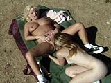 Two sexy all natural blondes are having hot girl on girl sex outside on a blanket.  They take turns finger banging and licking each other's pussy.  Next, they bust out their little white vibrator and pleasure each other.