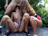 Two young college coeds are at the poolside and blowing on a guy's dick like it's an inflatable raft.  The two girls tag team the guy's cock  to extract the yummy goodness out of it.