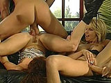 Chloe, a cute brunette, is sharing a big dick with her hot blonde friend Tara.  These two girls take turns having their cunts pounded, but while waiting for her turn on the cock, Chloe enjoys a hot ride on her big dildo that is stuck to the coffee table.