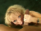 A hot big titty blonde is bobbing her head up and down on a big johnson. She mouth fucks him until he's ready to blow his load on her face.