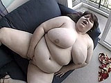 This is two BBW movies all in one click.  It starts off with a really large brunette finger fucking the hell out of her massive pussy.  That's followed by a slightly slimmer brunette sucking on some guy's big hard cock until he's nuts all over her face.