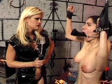 This sick and twisted mistress is inflicting maximum punishment to her slave.  The petite little brunette slave gets clamps locked on to every sensitive part of her body, and that is just the beginning.
