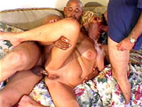 A sexy blonde is getting fucked in her ass by a big black cock as her husband just watches. She gives the black monster a thorough once over with her mouth before getting royally fucked in her pussy.