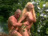 A hot blonde with big titties and a big dick guy are in a hot and steamy version of Adam and Eve.  It starts with Eve getting her pussy tongue fucked by Adam before taking a ride on his massive cock.