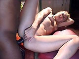 Jasmine Klein, a cute white chick, is banging a black guy with a big black dong. She gives a big smile as he blows his wad all over her face.