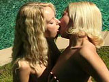 Two absolutely stunning blondes are satisfying one another's sexual needs with a dildo outside on a blanket.  Before passing the dildo back and forth between themselves, they have a hot and heavy makeout session with some red hot finger fucking mixed in.
