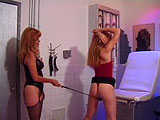 A slender blonde, becomes a slave for hire. The Dom starts the treatment with a riding crop. She taps away at her pussy, progressively making the strokes harder and harder. The younger girl eventually gets stripped of her clothes as the cropping continues.  Submissive is placed in arm bondage, strap