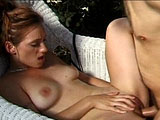 Mariah, a sexy redhead, is taking a big hard cock in her cunt by the pool.  Her sexual experience begins when she gets her panties ripped off and her pussy tongue fucked.  After her tongue fucking, she gets a real good fucking by a big massive cock.