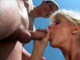 Sherilyn, a divorced blonde mom, fucks her son's friend.  He may be a virgin, but she can teach him all he needs to know.