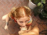 Cherry Poppens, a teen redhead, shows up and sucks some cock.  Her face gets fucked good.