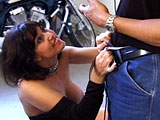 An older big chested brunette woman gets naked on a motorcycle for a photoshoot.  This photshoot leads into a porn shoot, where she ultimately takes it in the ass.
