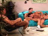 These three hot guys can't find anything to occupy their time.  So instead of sitting around with dicks in their hand, they decide to sit around with their dicks in each other's mouth.