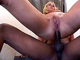 Aussie Amber, a sexy blonde, is sucking on a big black cock in a stairwell.  Once she's done slurping on some cock, she bends over, grabs her ankles, and takes a big black one up her ass.  She finishes up on her knees, begging for a mouthful cum.