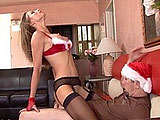 Bianca is waiting on the couch for her man in a sexy holiday outfit, and he comes home with a bag of goodies for her.  She strips out of her clothes and offers up her goodies instead.  He eats her nearly shaved pussy and she sucks his cock.  He pounds her pussy on the couch until blowing a big, crea