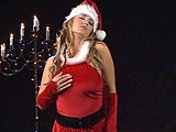 In this festive scene, Trina Michaels does a tease dressed in a sexy Santa outfit before shoving a red dildo in her pussy.  She gives a blowjob to a guy and fucks him with her massive jugs.  Trina then bounces up and down on his cock, taking it in both of her warm holes.  She takes an open mouth fac