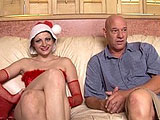Nikki Nievez is dressed in a sexy Santa outfit in this scene.  She deepthroats cock and he sucks her feet.  Nikki rides cock and uses a vibrator to aid in her pleasure.  The guy blows his load in her pussy and it oozes all out.