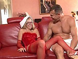 Tabitha James is lounging on the couch in a sexy Christmas outfit as a present for her man.  They exchange some hot oral, and then the guy slides in to Tabitha's demon hole.  He unloads his cum inside her pussy, and then it explodes out of it.