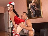 Eva Ellington is dressed as Santa's little helper in this scene.  Her man loves the present and unwraps her so he can get to the good stuff.  He eats her pussy thoroughly and she then sucks his cock.  He pounds his present repeatedly on the couch and blows his load inside of her.