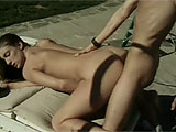 In this scene, Brandi Lyons gets with her husband outside on a chaise.  Fist Brandi gets her bald twat eaten and fingered, and then she returns the favor with a nice BJ.  They fuck in a couple positions until Scott pulls out an blows his load on Brandi's ass.