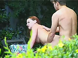 This redheaded Aussie is Vivi Anne.  She is all natural and in this scene she is outside with her man for some fun.  They exchange oral and fuck in a chair until Vivi Anne gets baby gravy dumped on her tongue and chin.