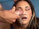 A smoking hot Asian is getting her cute pussy fucked nice and hard.  She looks amazing bouncing up and down as she rides the dude's big cock.  After a long and orgasmic pounding to her pussy, she strokes the dude's meat flute off all over her face.