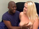 This cute blonde is getting fucked by a well huge black stud. She sure loves to smoke black pole!  He pokes her wet pussy in a bunch of different positions before dropping a nut bomb on her face.