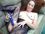 This amateur scene features Navaya and her dildo.  She is wearing a crotch-less bodysuit on the couch, and diddles herself with her fingers to get warmed up.  Navaya fucks herself with the vibrator until she cums.